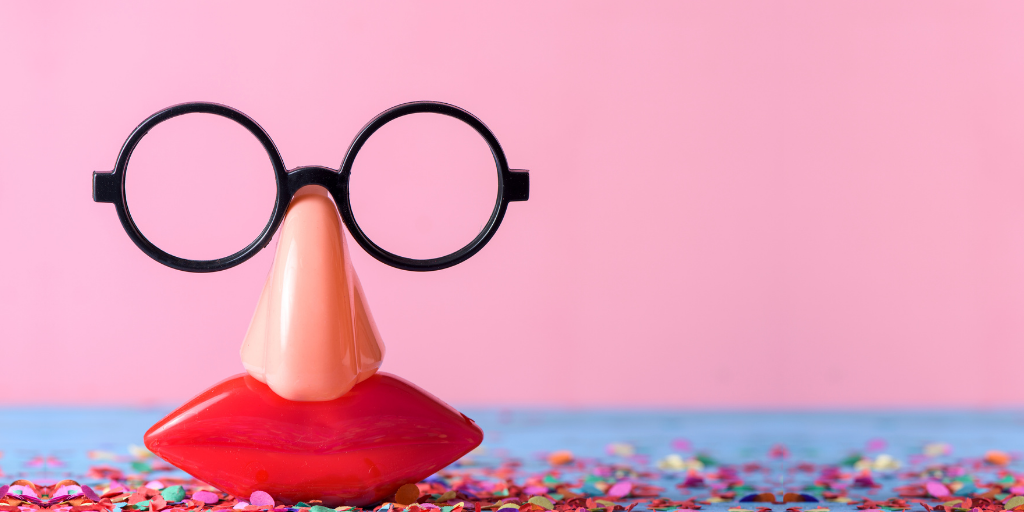 A set of plastic glasses, nose and mouth with a pink background
