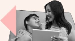A mother and son using a tablet