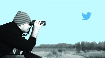 black and white siloed photo of a man looking through binoculars at a twitter logo