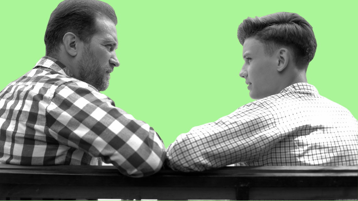 father and son talking on bench with green background