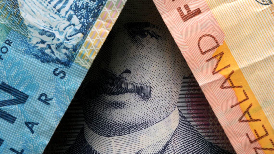 new zealand money overlaid to artistically cover a face