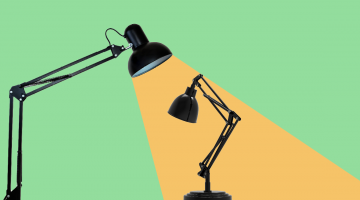 larger desk lamp overlooking a smaller more crumpled desklamp