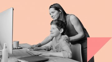 mother helping teenage son with desktop