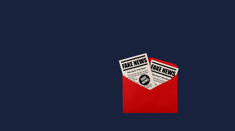 A red envelope containing two newspapers with the headline 'FAKE NEWS'