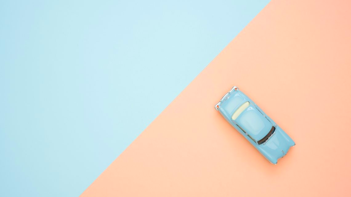 A car driving across two triangles