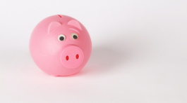Image of a pink piggy bank sitting on a white background